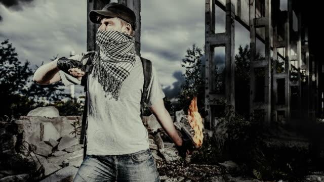 man with a molotov cocktail - terrorism bildbanksvideor och videomaterial från bakom kulisserna