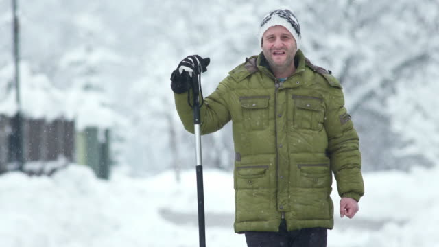 hd: man with a shovel standing in snow - spade stock videos & royalty-free footage