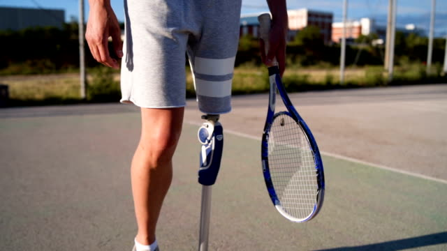 man with artificial limb playing tennis - prosthetic equipment stock videos & royalty-free footage