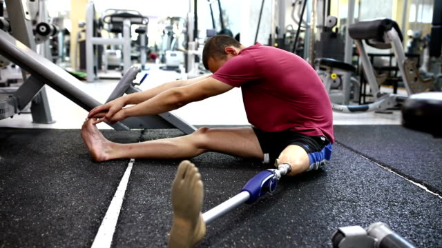 Man with artificial limb stretching