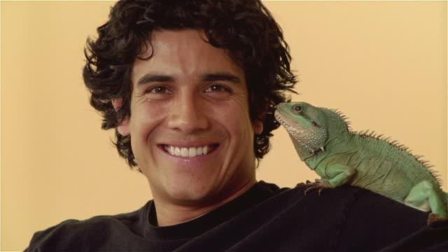 CU, Man with Asian dragon on shoulder, portrait