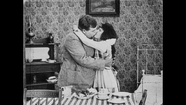 1919 man with bad breath (fatty arbuckle) kisses pretty woman (molly malone) - smelling stock videos & royalty-free footage