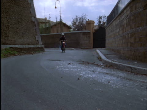Man with basket of oranges falls from his moped Italy