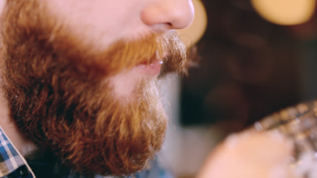 ecu man with beard drinking a beer - moustache stock videos & royalty-free footage