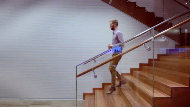 man with beard going down stairs - stock video - steps stock videos & royalty-free footage