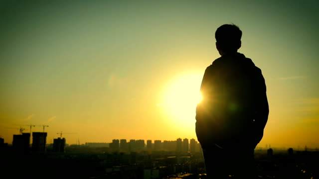 Man with beautiful sunset
