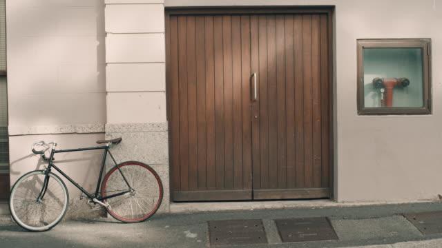 Man with bike on sidewalk