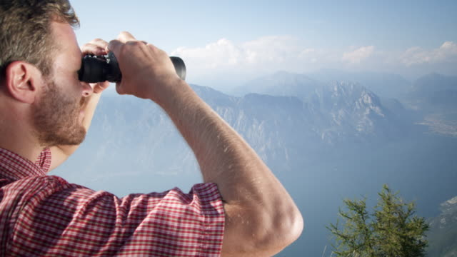 man with binoculars - looking through an object stock videos & royalty-free footage