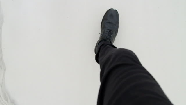 slo mo ms pov ha man with black pants and shoes walking through sand / jacksonville, florida, usa - walking point of view stock videos and b-roll footage