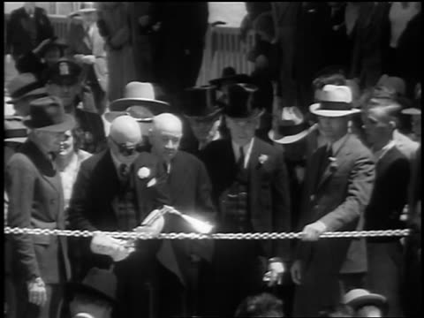 b/w 1937 man with blowtorch cutting chain in opening of golden gate bridge / san francisco / newsreel - opening event stock videos and b-roll footage