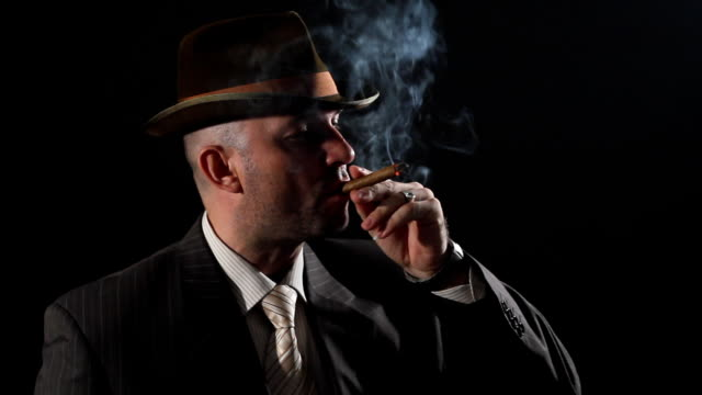 man with bowler hat and cigar - organized crime stock videos and b-roll footage