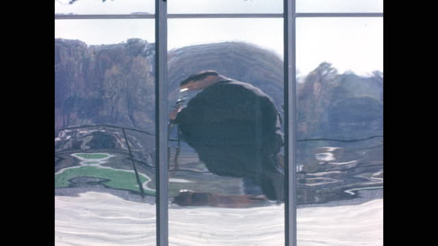 1962 - man with camera and tripod reflected in dramatic distortion glass - distorted stock videos & royalty-free footage