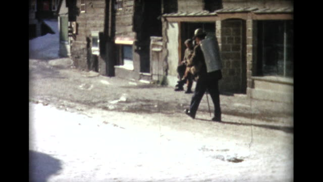 1963 man with cane trudging up snowy street - jug stock videos & royalty-free footage