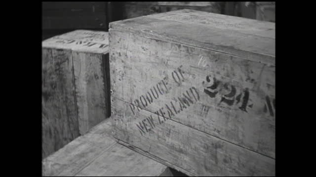 """man with clipboard standing by the doorway and writing, worker pulling cargo passing by; sacks being stacked together labeled """"product of british... - 1940 1949 stock videos & royalty-free footage"""