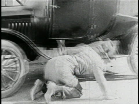 b/w 1925 man with coat caught in car door as it drives off + drags him with it / feature - 1925 stock videos & royalty-free footage