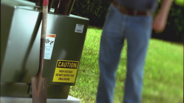 slo mo ms tu selective focus man with cowboy hat standing in front yard next to ground transformer and talking on cell phone / cedar park, texas, usa - cedar park texas stock videos & royalty-free footage