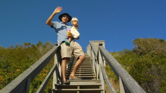 la, zi, cu, man with daughter (2-3) waving on beach steps, north truro, massachusetts, usa - hat stock videos and b-roll footage