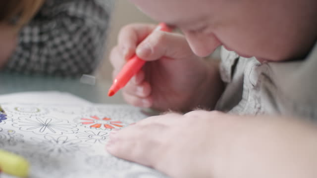 man with development disability coloring - disability stock videos and b-roll footage