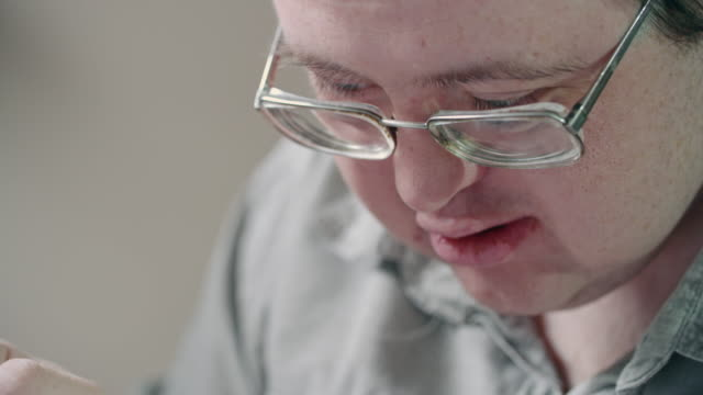 man with development disability enjoying painting - gouache stock videos & royalty-free footage