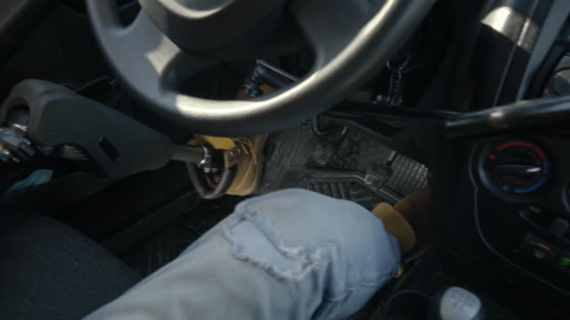 man with differing abilities driving car with ease - limb body part video stock e b–roll