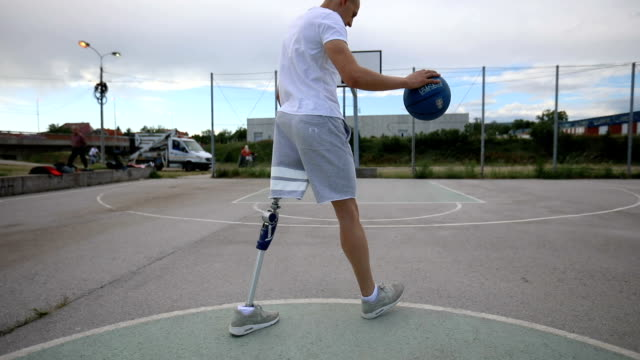 man with differing ability playing basketball - amputee stock videos & royalty-free footage