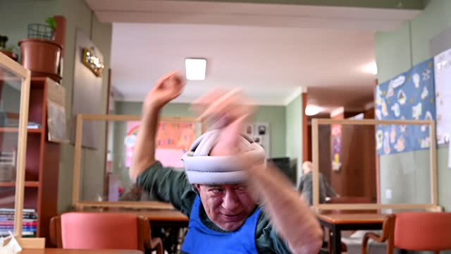 man with disability dancing inside at the paradigma social cooperative on april 20 in turin, italy. the paradigma social cooperative of turin deals... - intellectual disability stock videos & royalty-free footage