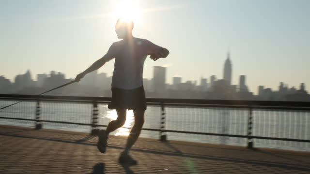 man with dog running