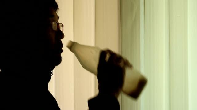 man with eyeglasses drinking milk from bottle - milk bottle stock videos & royalty-free footage