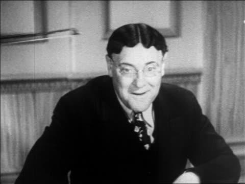 stockvideo's en b-roll-footage met b/w 1936 man with eyeglasses getting toupee knocked off head by violin bow / feature - pruik