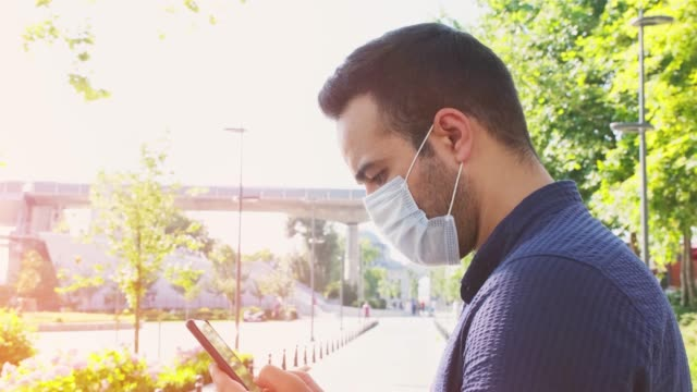man with face protective mask, social media concept. wearing medical masks during the coronavirus covid-19 outbreak. - vivid filter. 4k video. - iran stock videos & royalty-free footage