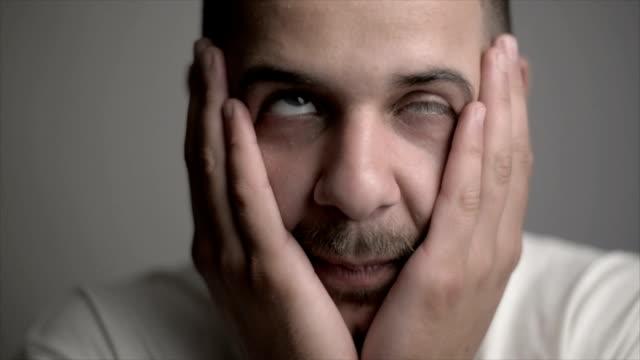 man with facial tics - cranial nerve stock videos & royalty-free footage