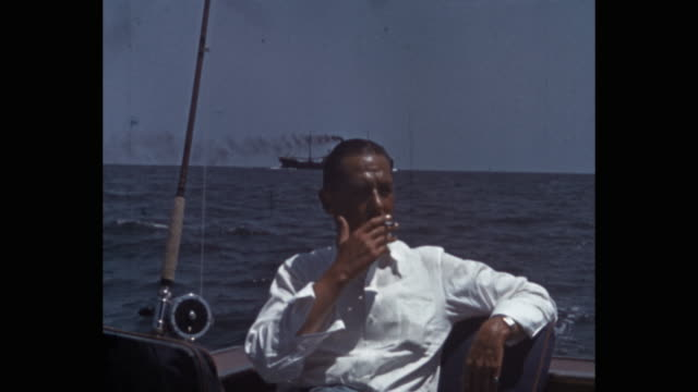 man with fishing rod smoking cigarette while sitting in yacht, florida, usa - 1941 stock videos & royalty-free footage