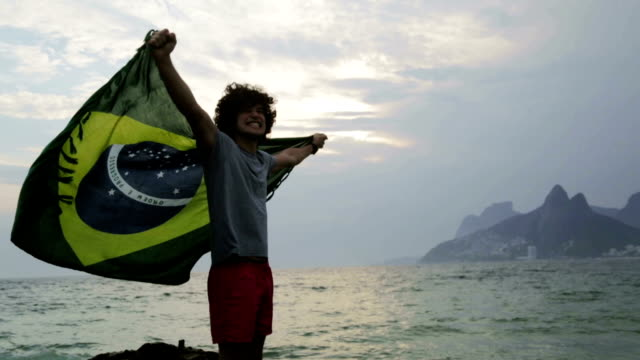 man with flag on beach - hd format stock videos & royalty-free footage