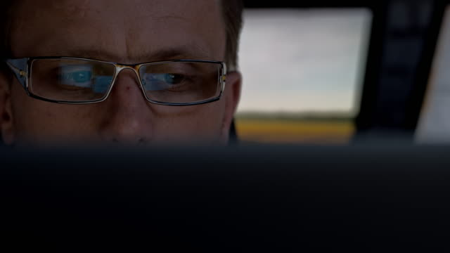 Man with glasses working on a computer