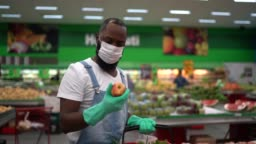 Man with gloves shopping in supermarket