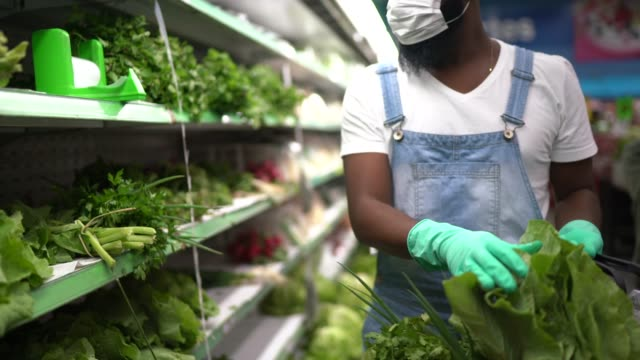 man with gloves shopping in supermarket - leaf vegetable stock videos & royalty-free footage