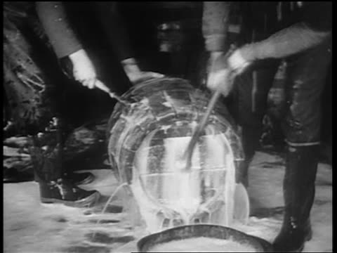 b/w 1932 man with hammer smashing lid of barrel / beer pouring out of barrel onto floor / chicago - anno 1932 video stock e b–roll