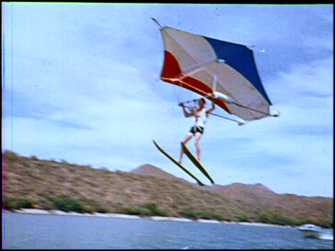 xws man with hang glider on water skis / ws man lifts off the water into the air / ws man with hang glider sailing in the air / ws pov of hang glider... - hang gliding stock videos & royalty-free footage