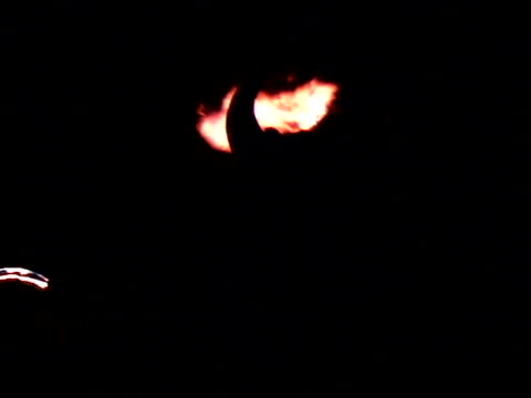 stockvideo's en b-roll-footage met man with horns watching flame bursts at night - ceremonie