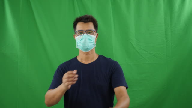 a man with hygienic mask on green screen - negative emotion stock videos & royalty-free footage