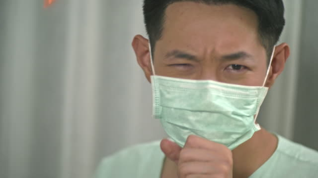 a man with hygienic mask - asian man coughing stock videos & royalty-free footage