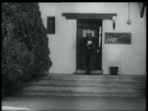 b/w 1952 man with jet pack on exits from building + takes off into sky - 1952 stock videos & royalty-free footage