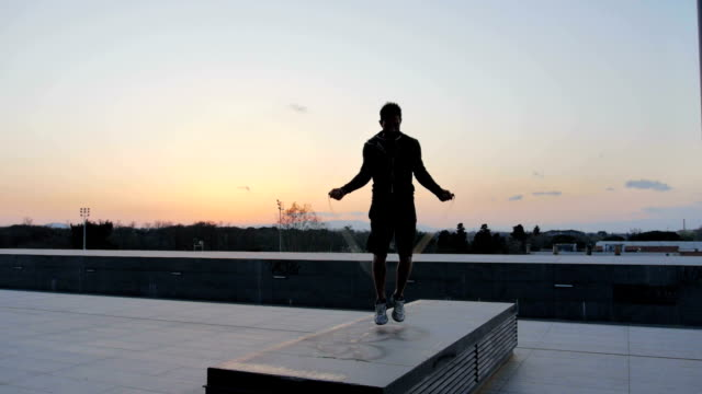 man with jump rope on rooftop - hopprep rep bildbanksvideor och videomaterial från bakom kulisserna