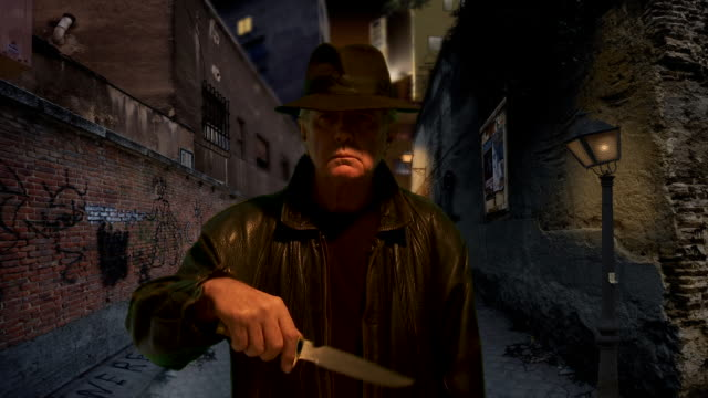 Man with knife in alley