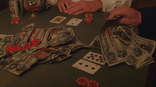 MS TD POV Man with large mustache playinng poker with friends / United Kingdom