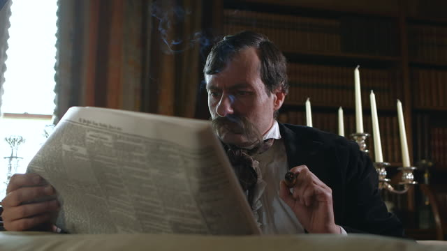 cu pov man with large mustache sitting reading newspaper / united kingdom - historische szene stock-videos und b-roll-filmmaterial