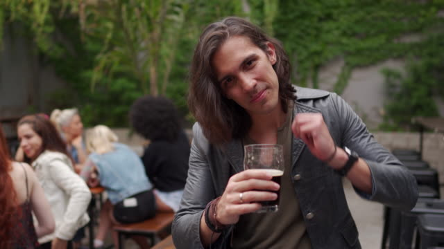 man with long hair in the pub - long hair stock videos & royalty-free footage