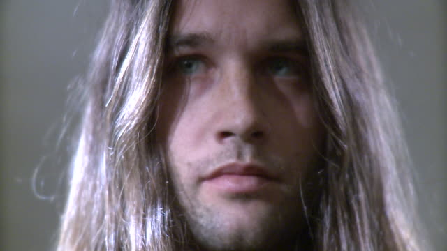 cu man with long hair looking sideways in studio - long hair stock videos & royalty-free footage