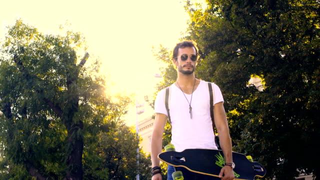 Man with longboard walking