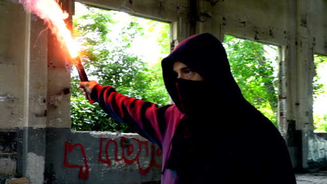 man with mask and hoodie holding flare - rapper stock videos & royalty-free footage